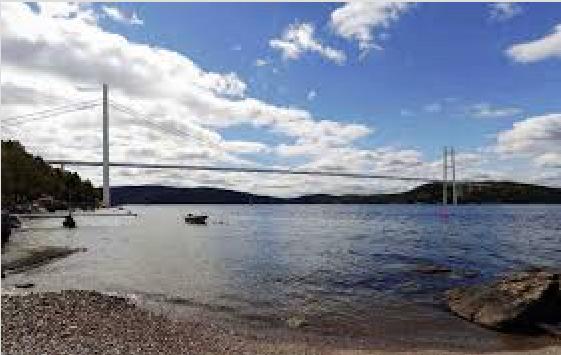 Bro har en samfunnsøkonomisk nytteverdi som er 18 milliarder kroner høyere enn tunnel – og kan bli et vakkert tilskudd i landskapet rundt Oslofjorden. Illustrasjon: Statens vegvesen, Rambøll